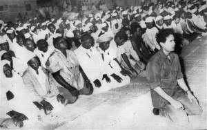Muammar Gaddafi praying at mosque