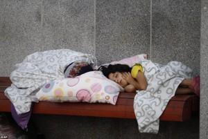 Homeless Child Refugee sleeping in train station