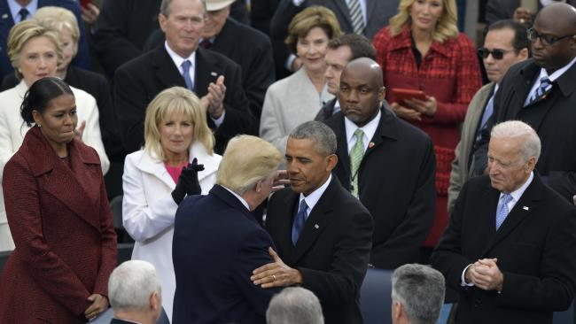 Donald Trump and Barack Obama shake hands at Trump's Inauguration